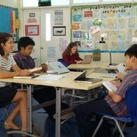 Ms Jacskon discussing literature with MYP students - mother tongue image