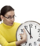 Woman pointing clock time isolated  white