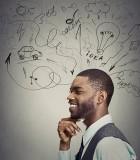 Closeup-portrait-happy-young-man-has-many-ideas-000070677655_Large
