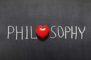 philosophy word handwritten on chalkboard with heart symbol instead of O