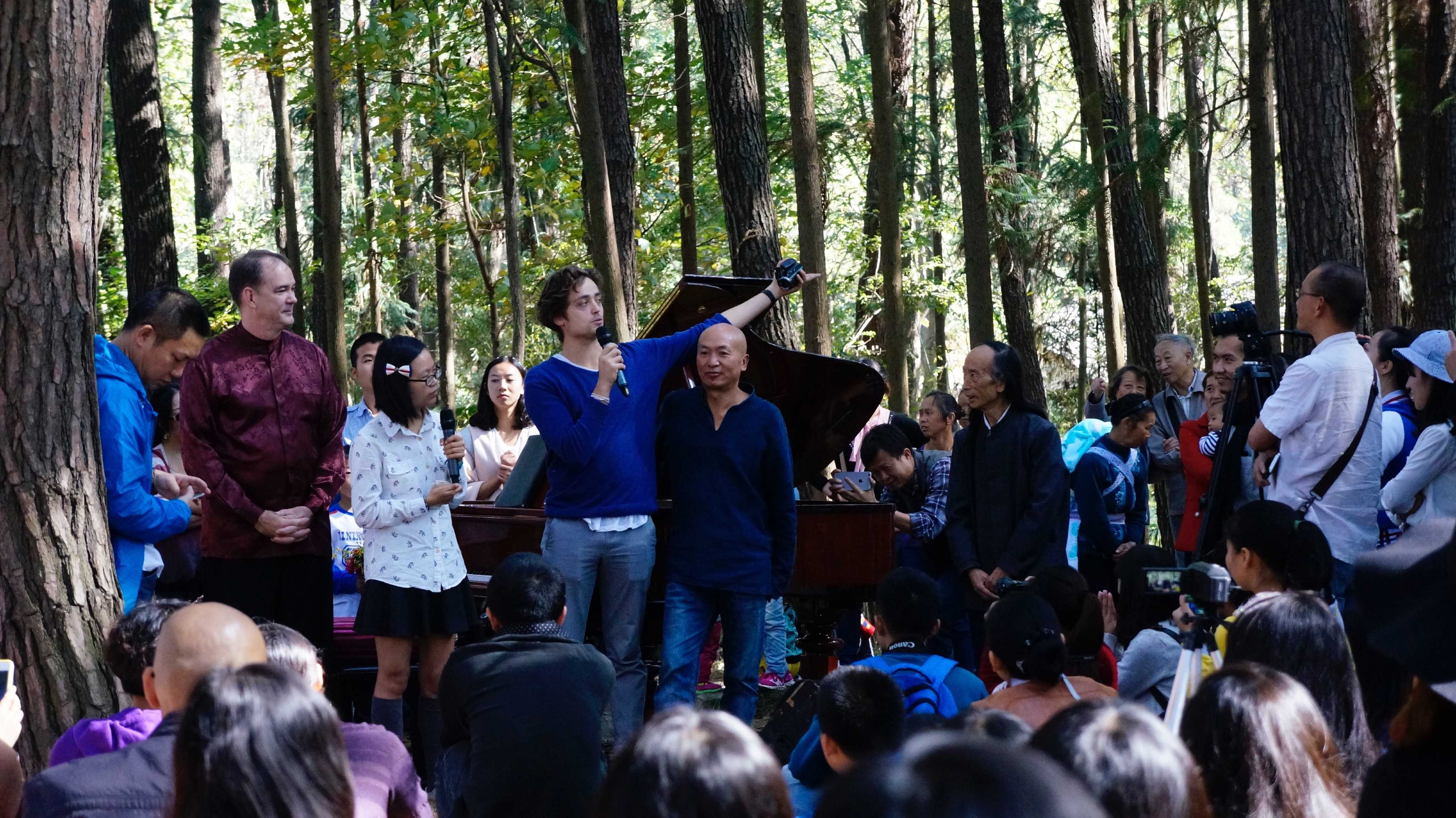 Jeremie Gluckman serves as Emcee during an outdoor Piano concert at the Guizhou University of Finance and Economics.