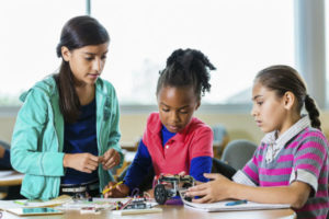 Little-girls-building-robots-during-science-class-after-school introvert optimized