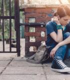 Depressed girl sitting on ground