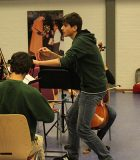 Alex-rehearsing-the-combined-orchestras-at-the-British-School-in-the-Netherlands-600