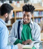 iStock_Teacher_Speaking_Student_Library 1.1