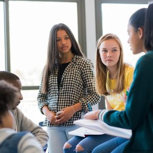 iStock_Group_Studnts_Discussing_Classrom 12x6