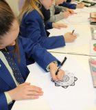 Student designs a Mandala during their school's IB Week
