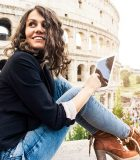 iStock_Smiling_woman_in_front_of_Colosseum 12x8