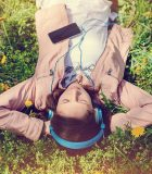 iStock_Teenage_girl listening_to_music_in_the_park 600 sq