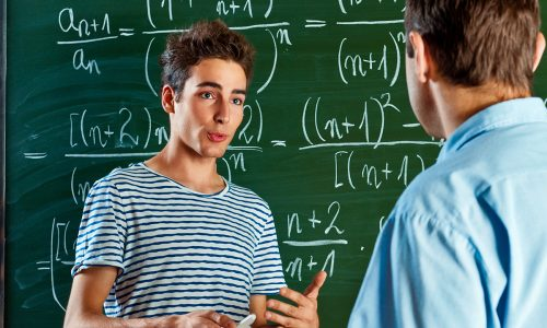 iStock_Male_Student_Explaining_Maths_Blackboard_Double