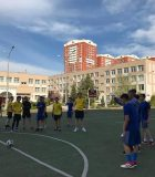 Students competing in the football tournament.