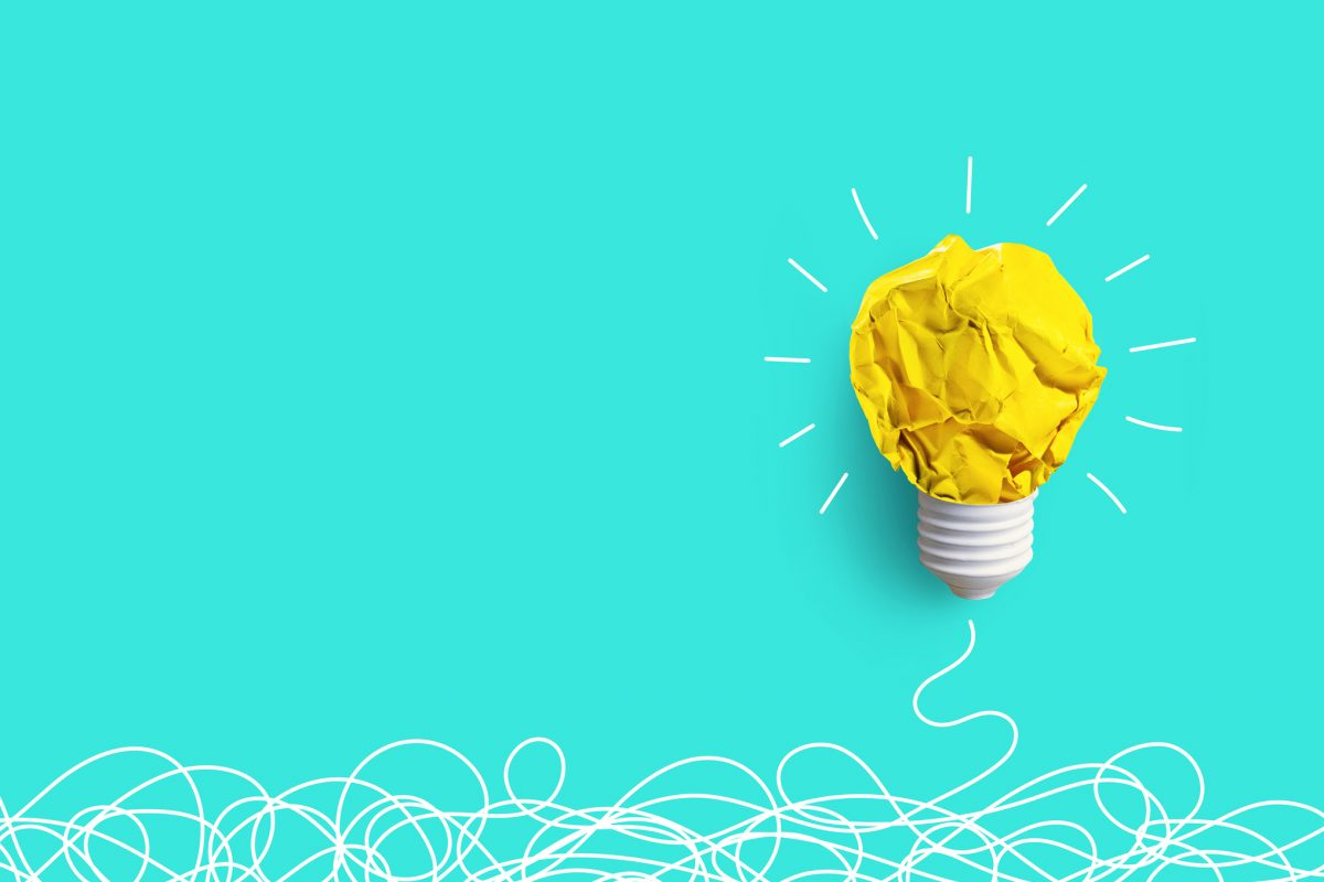 Creativity inspiration,ideas concepts with lightbulb from paper crumpled ball on pastel color background.Flat lay design.
