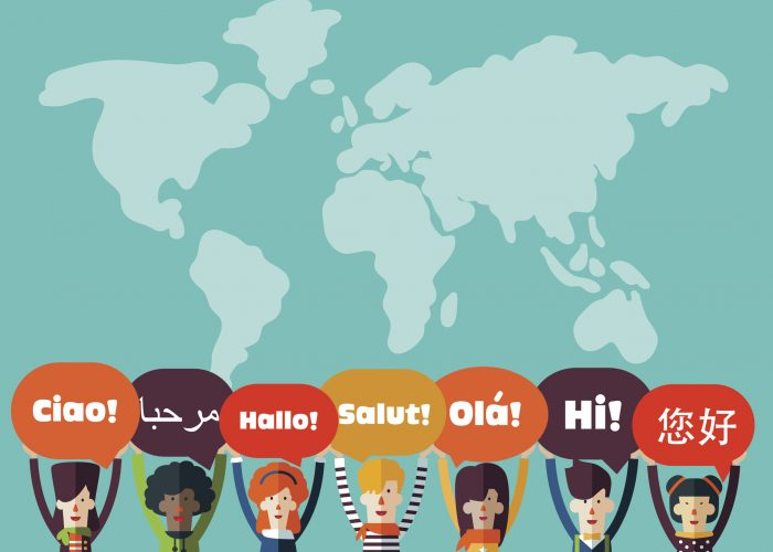 Group of happy smiling young people with speech bubbles in different languages. Male and female faces avatars in modern design style. Communication, teamwork, assistance and connection vector concept
