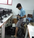 Rishit Jan sorting through the electronic waste collected by the REUSE team.
