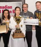 Jenny receiving the first place trophy and a cash prize of CA$1,500 for winning the Canadian National Brain Bee Competition