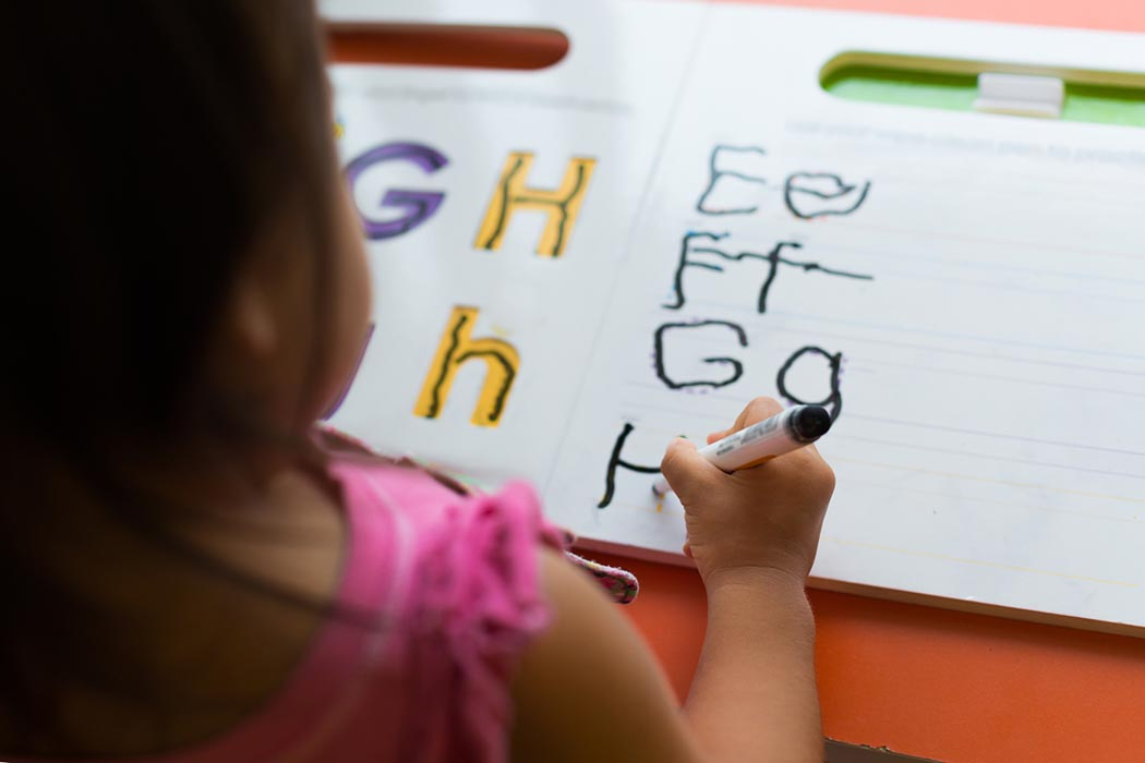 kids learning in classroom. homeschooling concept. close of tracing the alphabet