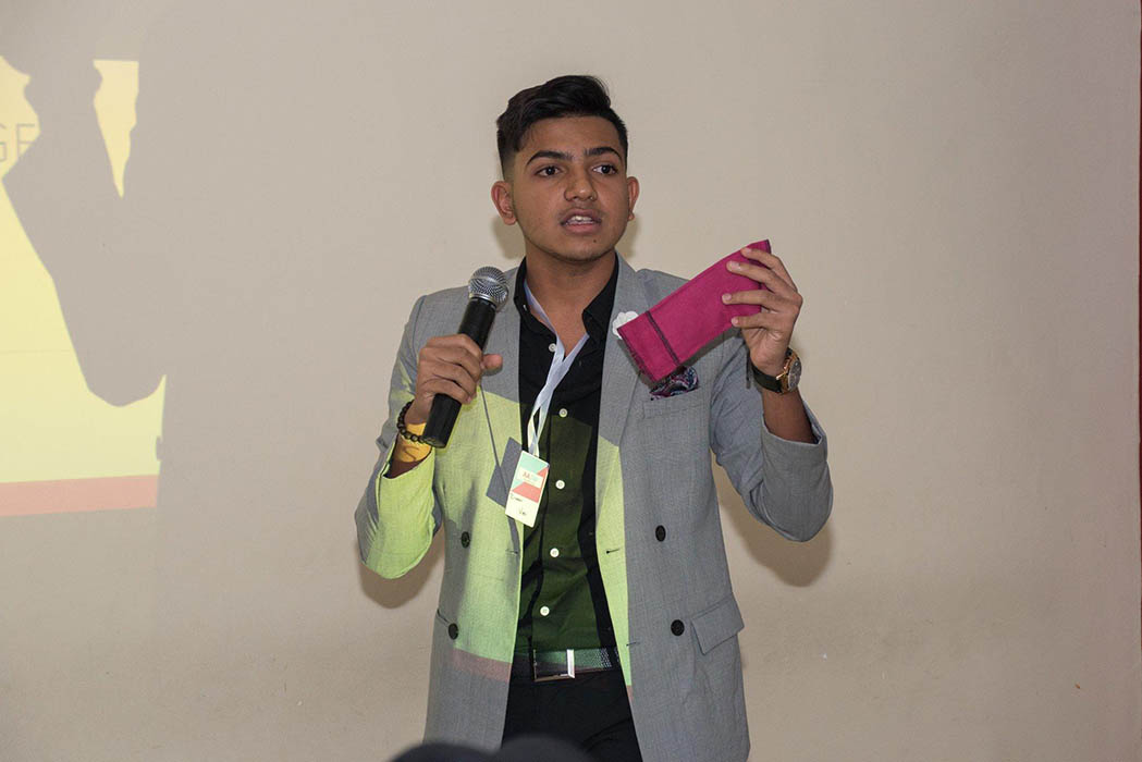 Ziyaan Virji presenting his sanitary pads that are washable (therefore re-usable).