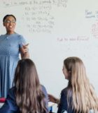 Female teacher discussing STEM: Mathematics during class.