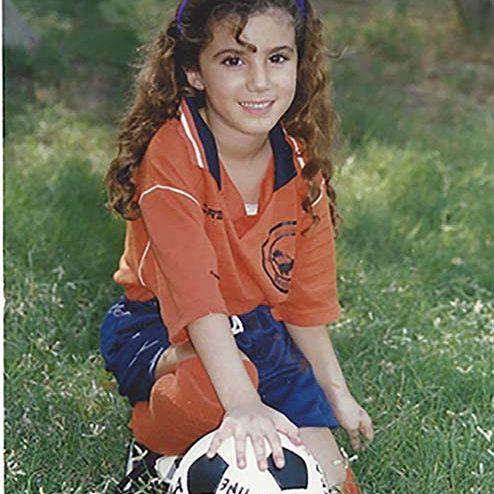 Saja Kamal playing football in her backyard.
