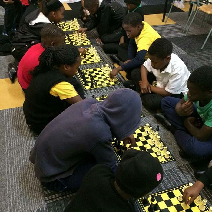 Students competing in a chess competition.