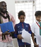 UoPeople scholarship recipient and Middle Years Programme (MYP) teacher Timoteo with his students.