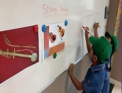 Music - Junior Kindergarden students identifying the musical instruments.